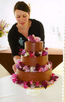 Chocolate buttercream tiers with fresh lilacs and sweet peas. Photo courtesy of Ron Bolander Photography  www.ronbolander.com