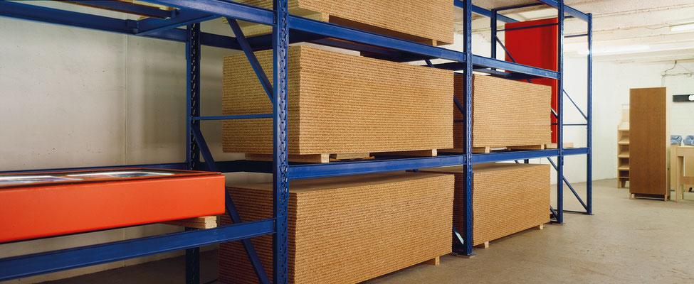 Zwischenlager   1988   3 photographs   high rack   particleboard   137.8 x  314.7 x  49.2 in.   350 x 800 x 125 cm