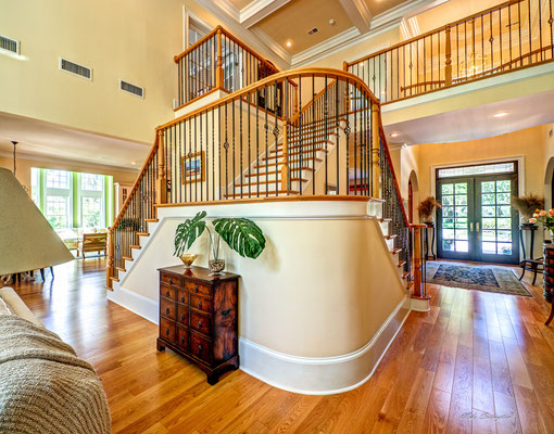 Notice the curved base of the stairs adding elegance to the room