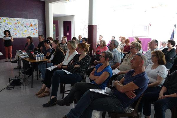 Les participants suivent avec intérêt la présentation du rapport d'activités de l'année 2018.