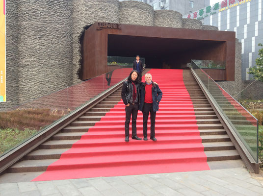 With gallerist Klaus Kiefer in front of the entrance to the Sonzhuang Art Center, Beijing