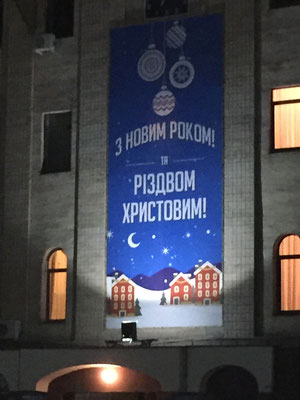 Sign outside of the city government building wishing everyone a Happy New Year and a Merry Christmas