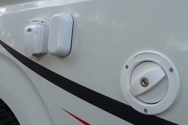 power and antenna inlets with water filler on driver side 1/4 panel