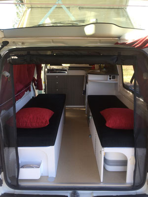Clasic single seat or bed set up- walk thru to the reear of the van