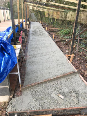 Concrete being laid and levelled