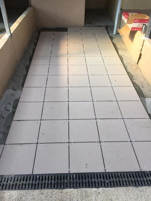 New pet friendly non slip tiles being laid on right block