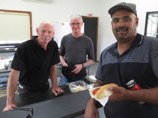 New canteen manager Allan Collins, centre, and his offsider Rob await Anton's verdict on the gourmet hotdog.