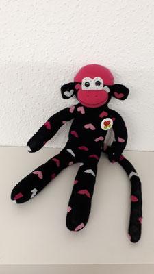 Sockenaffe, schwarz-pink