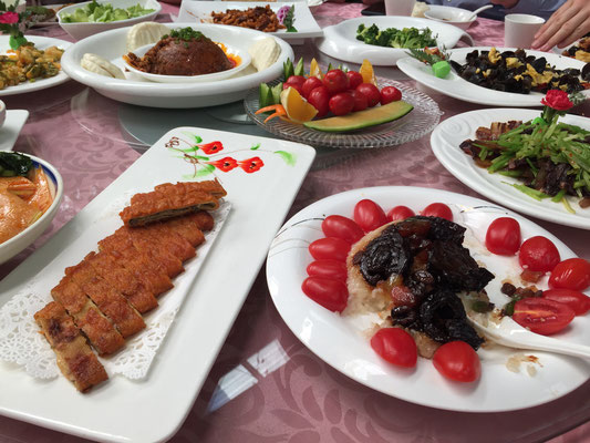 Rice with plums, tomatoes, filled pastry and different types of vegetables