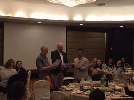 Prof. Zhang Li presents some gifts to Prof. Bopp and Prof. Schellhase