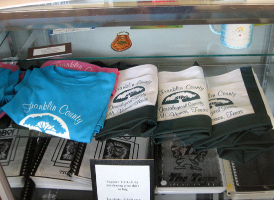 T-shirts and other merchandise available in the Society Research Room