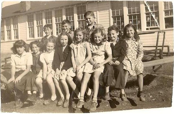 Hagansport School, ca. 1946-47. Left to right: Lucy Smith, Sue Banks, Peggy Swarts, Shirley Swinford, Unknown, Jane Elliott, Nell Crowston & Lillian Pennington. Boys: Glen Wayne Dyer (killed in bike accident July 1948), Charles Dyer & Gerald Holmes.