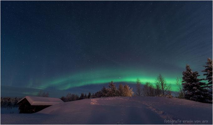 Nordlichter (Revontulet) über Äkäslompolo im finnischen Lappland