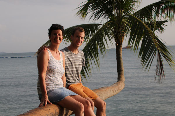 my mom and I sitting on the horizontal palm