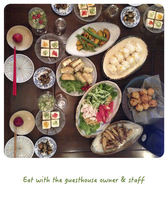 Eat with the guesthouse owner and staff