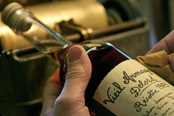 Labeling by hand at Armagnac Delord