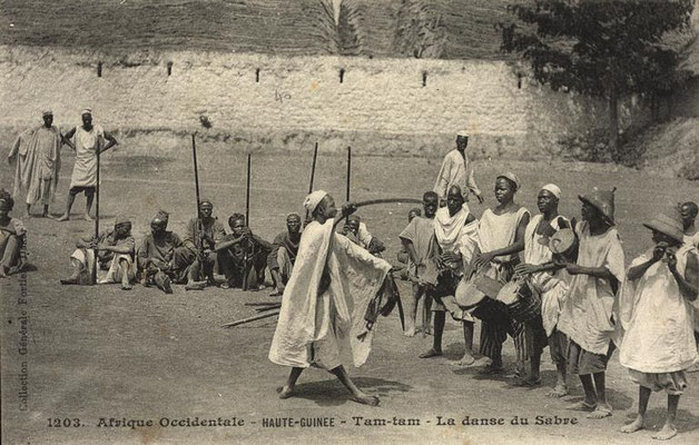 Jembe, tama (hourglass-drum), and flute players and warrior dance