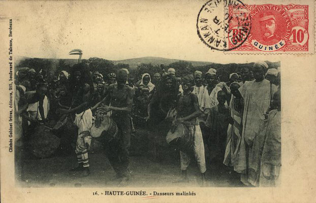 Jembe and dundun players, with bird mask