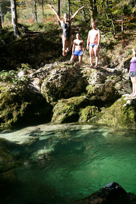 jumping in the mountain river. Slovenia