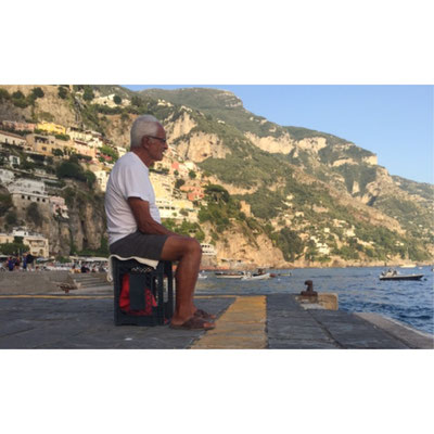 Captured an older gentleman fishing off the coast of Spiaggia Grande