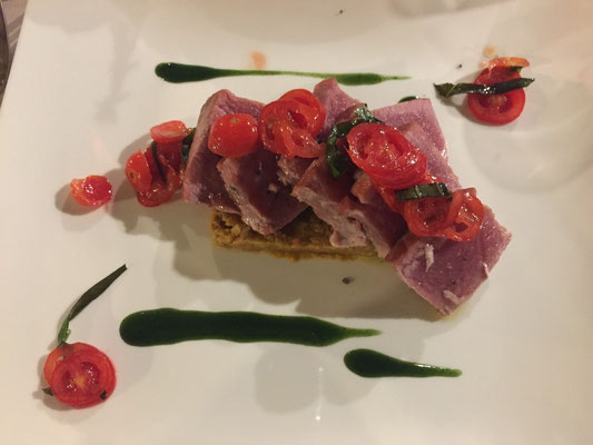 Seared tuna on panzanella with roasted tomatoes and pesto