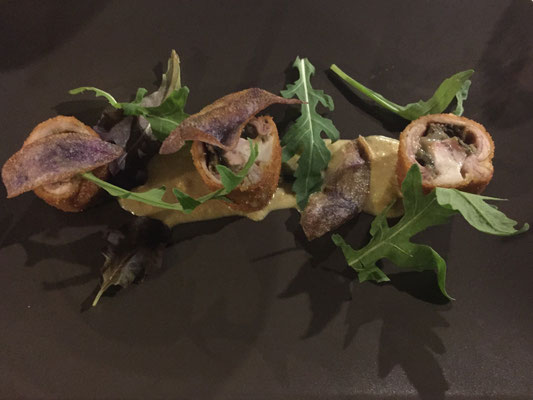 Rabbit stuffed with eggplant on apple curry sauce and garnished with thin banana chips and arugula