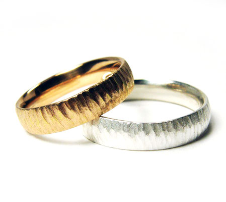 Sanfte Wellen• Damenring: Rotgold 750, Herrenring: Silber 935
