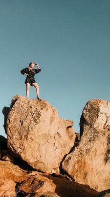 Stephanie on a rock
