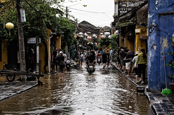 the road are passable again after heavy rainfall in Hoi An