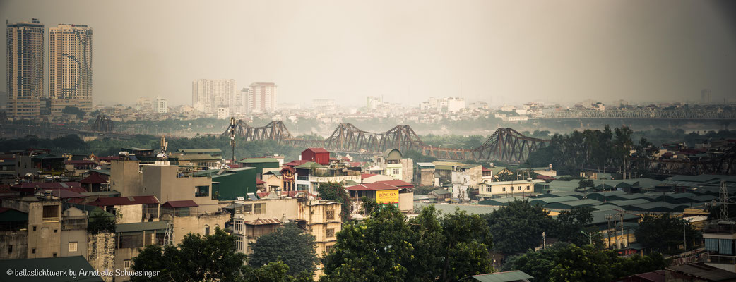 cityscape of Hanoi with the old train bridge
