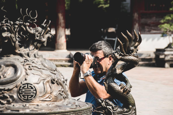 a photographer taking a picture of a photographer photographing his pic of the temple of literatur in Hanoi