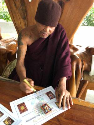 Baby Butterfly from Kruba Krissana signing certification for butterflyamulet.com