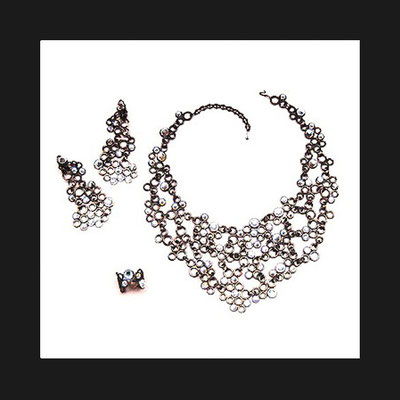 "Collection ""Luna"" - 1999 Ring, necklace and earrings. Articulated bronze elements set with rhinestones."