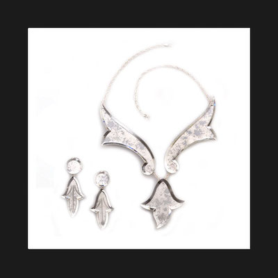 Necklace, brooch and earrings. Venetian mirrors hand-engraved and -bevelled. Silver chain.