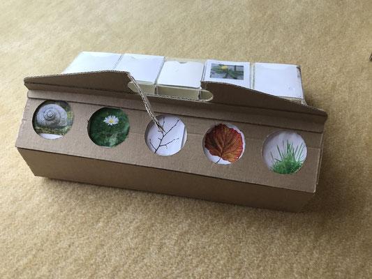 schlaubatz Sammelkiste: Erstes Modell aus Pappe mit Einsteckleiste.
