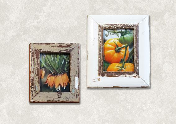 Due cornici design in cucina con foto arancioni su mattoni bianchi