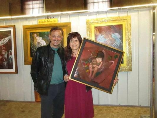 con l'artista Mario Zampedroni, nel mio stand, col mio ultimo dipinto, appena venduto