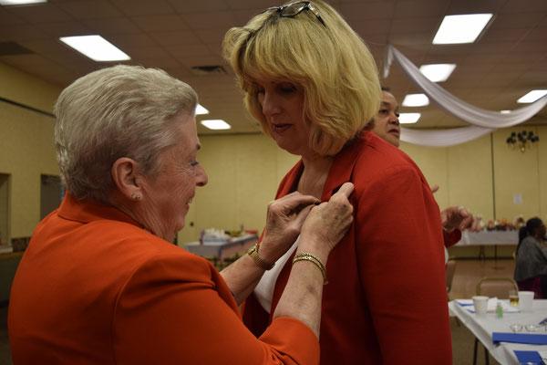 PNP Sally Redinger pins new Tent 3 member Melissa Waligora