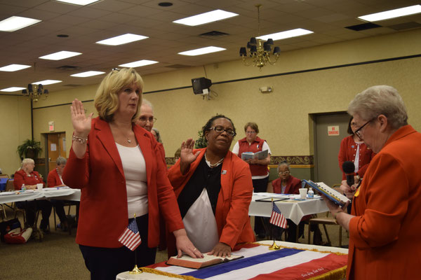 PNP Sally Redinger (right) swears in newly initiated Tent 3 members, Melissa Waligora and Yulanda Burgess