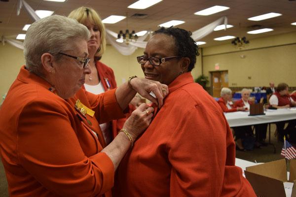 PNP Sally Redinger pins new Tent 3 member Yulanda Burgess