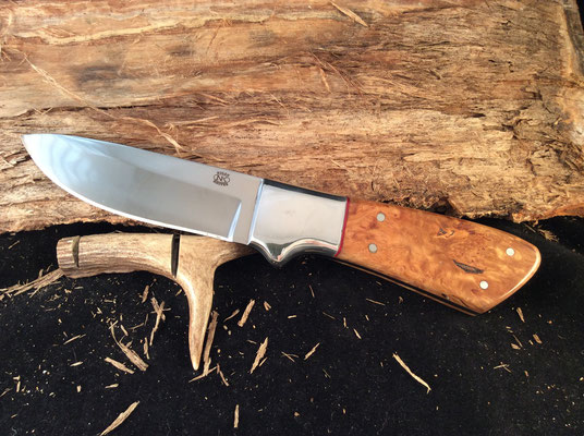 """#132 Full tang drop point.  Blade length 4 1/2"""" Overall 9 3/8"""".  Made with 440C.  Nickel silver bolsters.  Stabilized birdseye maple handle.  Maker RD Nolen  $275"""