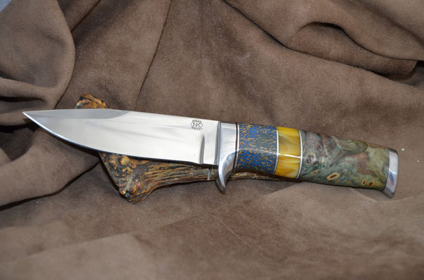 """#196 Narrow tang double edged clip point.  Blade length 4 3/4"""" Overall 9 1/8"""" Made with 440C.  Stabilized california buckeye with blue dyed osic and amber with aluminum guard and buttcap handle.  Maker RD Nolen  $375"""