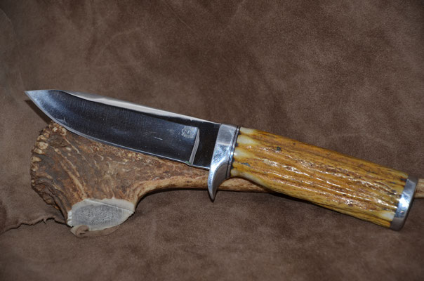 "#71 Drop point.  Blade length 4 1/2"" Overall 9"" 440c steel  Handle stag horn.  Aluminum guard and buttcap.  Maker Steve Nolen  $250"