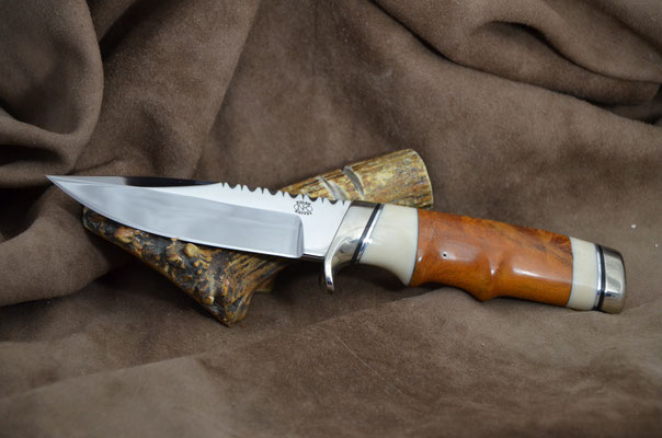 "#192 Narrow tang double edge clip point.  Blade length 4 1/2"" Overall 9"" Made with 440C.  Maple burl with white corrion with nickel silver guard and buttcap.  Maker RD Nolen $375"