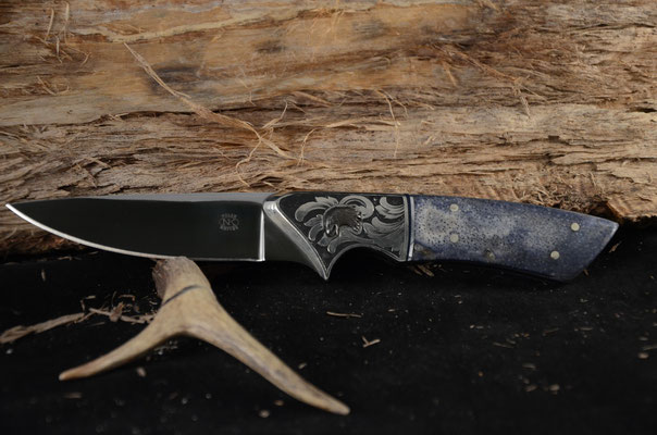 """#100 Utility knife.  Blade length 4"""" Overall 9 1/4"""".  Made with 440C.  Engraved Nickel Silver Bolsters with inlayed eagle head.  Blue Coral Handle.  Maker RD Nolen $750"""