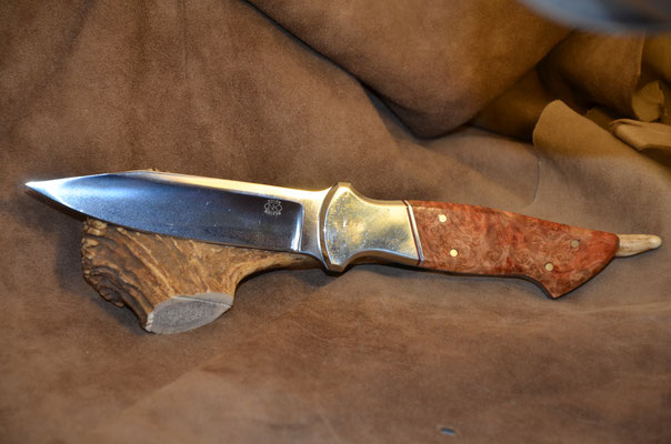 "#156 Full tang boot knife.  Blade length 5"" Overall 10"" Made with 440C.  Stabilized Birdseye maple with nickel silver bolster.  Maker RD Nolen  $300"