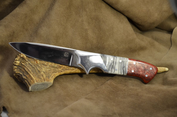 """#152 Full tang drop point.  Blade length 4 1/4"""" Overall 9 1/2"""".  Made with 440C.  Handle manmade black pearl with red stablized birdseye maple.  Maker RD Nolen  $300"""
