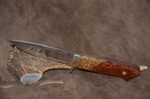 "#145 Classic drop point.  Blade length 4 1/2""  Overall 9 1/8"" 440c steel.  Handle stabilized birdseye maple burl.  Nickle silver guard.  Maker RD Nolen  $375"