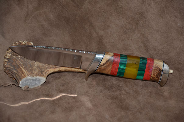 """#81 Blade 4 3/4"""" Overall 9 1/4""""  Drop point blade with 440c steel and file work.  Handle - stabilized maple burlwood, red coral, malachite and amber spacers.  Nickle silver guard and buttcap  $450"""