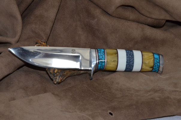 """#187 Narrow tang drop point.  Blade length 4 3/4 Overall 9 3/8"""" Made with 440C.  Turquoise-amber-white corrion-blue with white corrion, aluminum buard and buttcap handle.  Maker RD Nolen $450"""